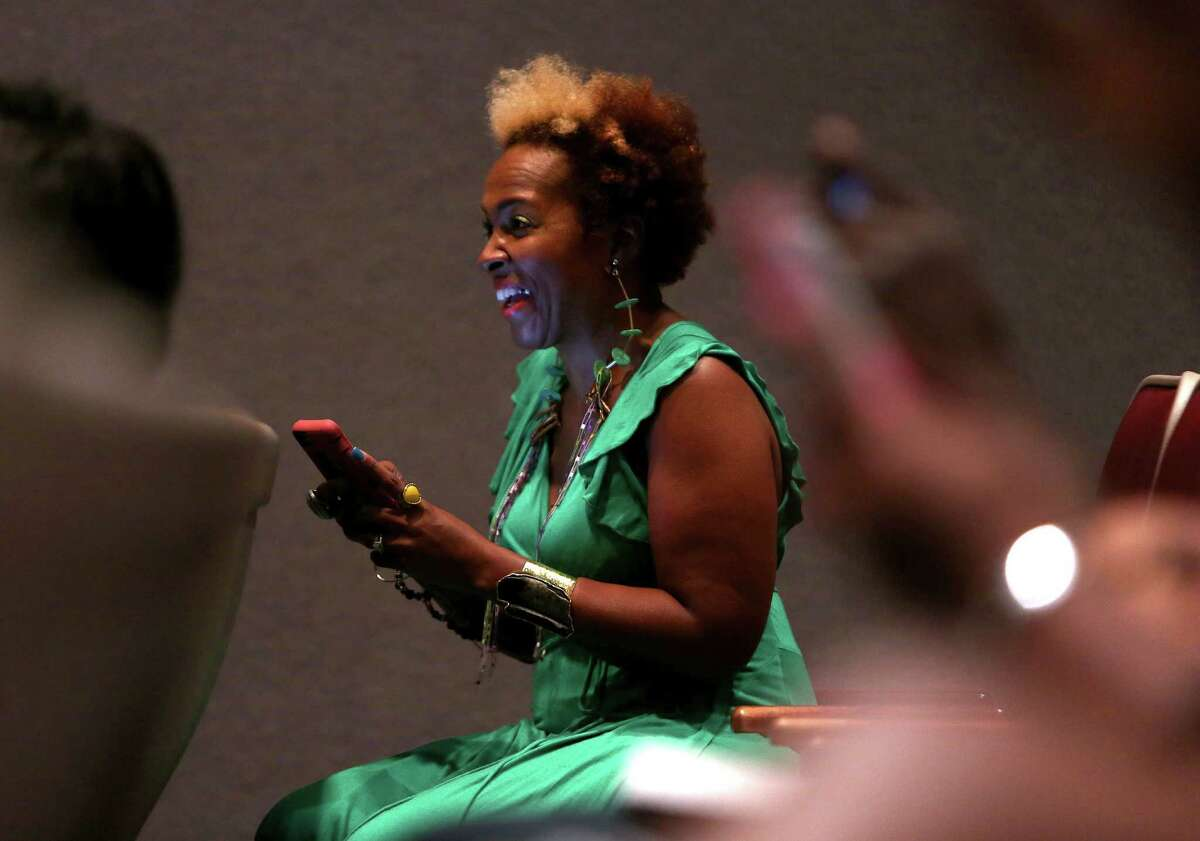 Yolanda Green, owner of Xpozher Accessories and Home, listens to speakers at the SWAG EXPOSE entrepreneur event on Sunday, Nov. 13, 2016, in Houston. (Annie Mulligan / Freelance)