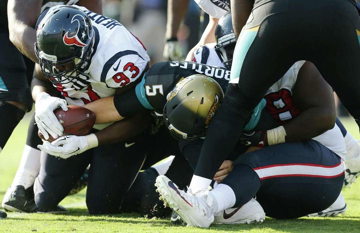 Houston Texans defensive tackle Joel Heath (93) and defensive end D.J. Reader sack Jacksonville Jaguars quarterback Blake Bortles (5) during the third quarter of an NFL football game at Everbank Field on Sunday, Nov. 13, 2016, in Jacksonville.