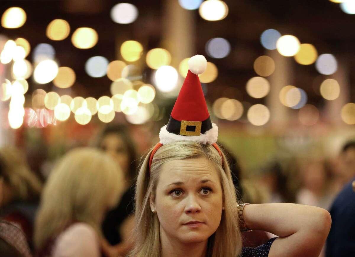 Aneta Locke wears a seasonal headband while shopping at the Nutcracker Market at the NRG Center on Sunday.