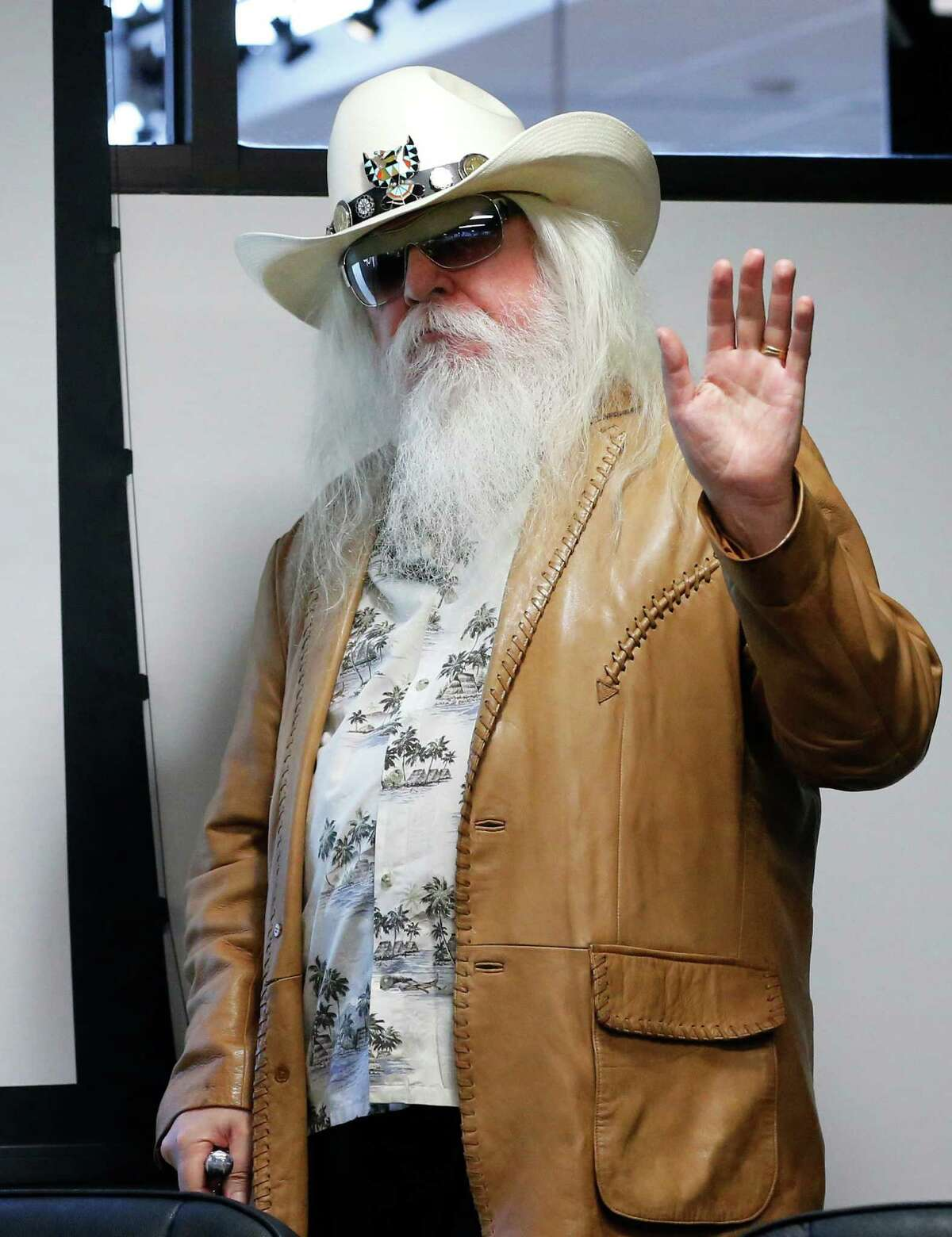 FILE - In this Jan. 29, 2013, file photo, Leon Russell waves as he is introduced in Tulsa, Okla. Russell, who sang, wrote and produced some of rock 'n' roll's top records, has died. (AP Photo/Sue Ogrocki, File) ORG XMIT: NY203