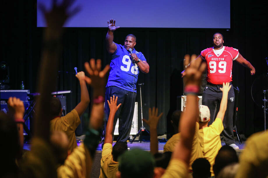 Keith Davis, a former NFL player, and Dominic Miller, a championship college football player, seek volunteers from the foster children audience during their motivational program at the Celebrate Me event on Saturday, Nov. 12, 2016, at The Woodlands United Methodist Church. Photo: Michael Minasi, Staff / © 2016 Houston Chronicle