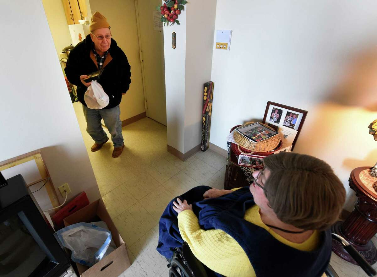 Meals on Wheels driver Joe Marcello Jr. makes a delivery to Marlene Straus at the Ohav Shalom apartments Friday Feb. 12, 2016 in Albany, N.Y. (Skip Dickstein/Times Union)