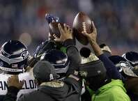 Seattle Seahawks players huddle up during warm ups before an NFL football game against the New England Patriots, Sunday, Nov. 13, 2016, in Foxborough, Mass. (AP Photo/Charles Krupa)