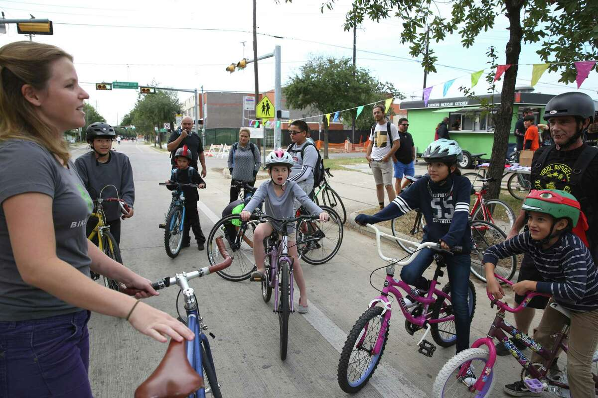 Mary Blitzer, member of Bike Houston, leads the Kidical Mass ride with young adventurers at Cigna Sunday Streets in Fifth Ward on Sunday.