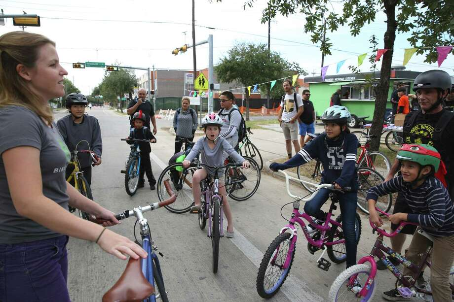 Mary Blitzer, member of Bike Houston, leads the Kidical Mass ride with young adventurers at Cigna Sunday Streets in Fifth Ward on Sunday.  Photo: Yi-Chin Lee, Staff / © 2016  Houston Chronicle