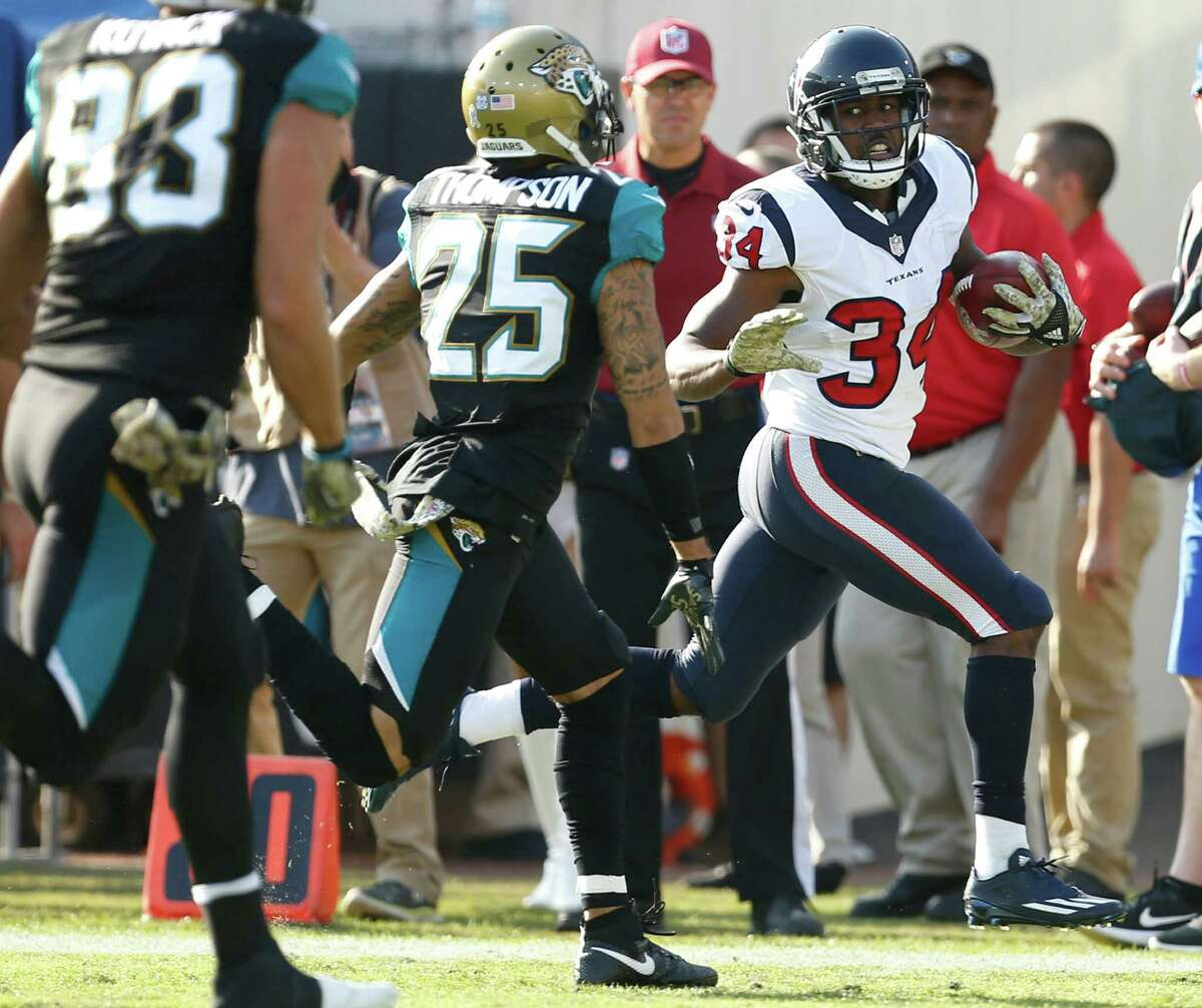 Texans running back Tyler Ervin (34) races up the sidelines past Jaguars defensive back Peyton Thompson (25) on a 57-yard punt return during the third quarter Sunday at Everbank Field in Jacksonville.