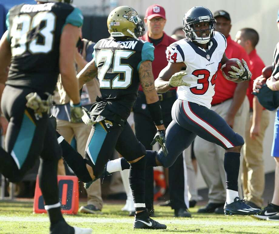 Texans running back Tyler Ervin (34) races up the sidelines past Jaguars defensive back Peyton Thompson (25) on a 57-yard punt return during the third quarter Sunday at Everbank Field in Jacksonville. Photo: Brett Coomer, Staff / © 2016 Houston Chronicle