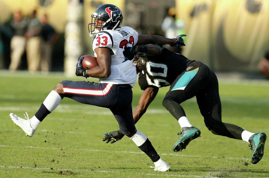 Texans running back Akeem Hunt (33) is hit by Jaguars outside linebacker Telvin Smith (50) during the fourth quarter Sunday in Jacksonville. Hunt gained 52 yards yards on eight carries. Photo: Brett Coomer, Staff / © 2016 Houston Chronicle