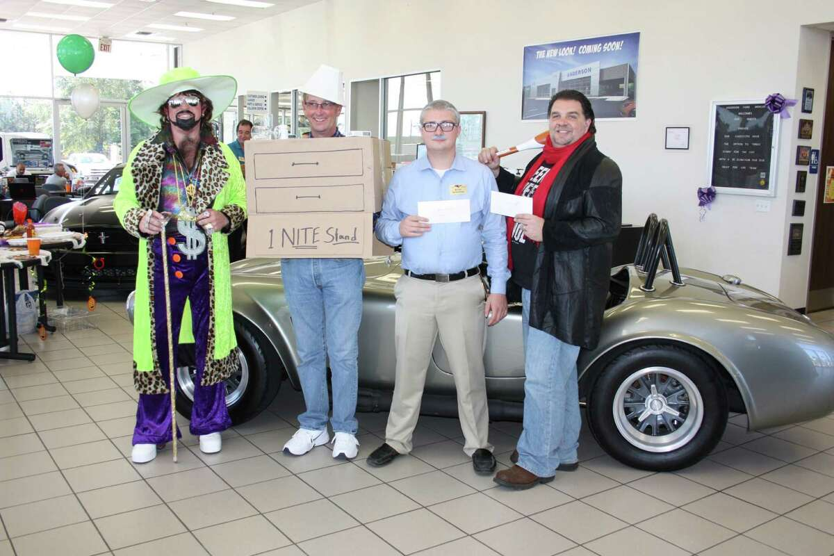 The winners of Anderson Ford's Halloween costume contest are (second from right to left) first place - Bruce Martin as a one-night stand, second place - Matt Coleman as the dealership's sales manager, and third place - Brad Crow as Negan from The Walking Dead. Perhaps the sharpest dressed person, though not competing in the contest, was Buck Anderson (far left).