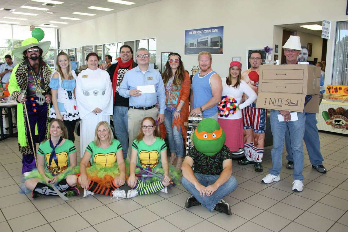 Anderson Ford-Mercury hosted a Halloween costume contest featuring employees who competed for prizes and bragging rights. Pictured left to right are (bottom row) Tish Runyon, Phyllis Runyon, Britney VanCamp, Justin Autrand, (top row) Buck Anderson, Kayla Hebert, Chase Bowersox, Brad Crow, Matt Coleman, Angela Onken, Chase Ahlberg, Wendy Roop, Caleb Flores, Bruce Martin and Clifton Wright.