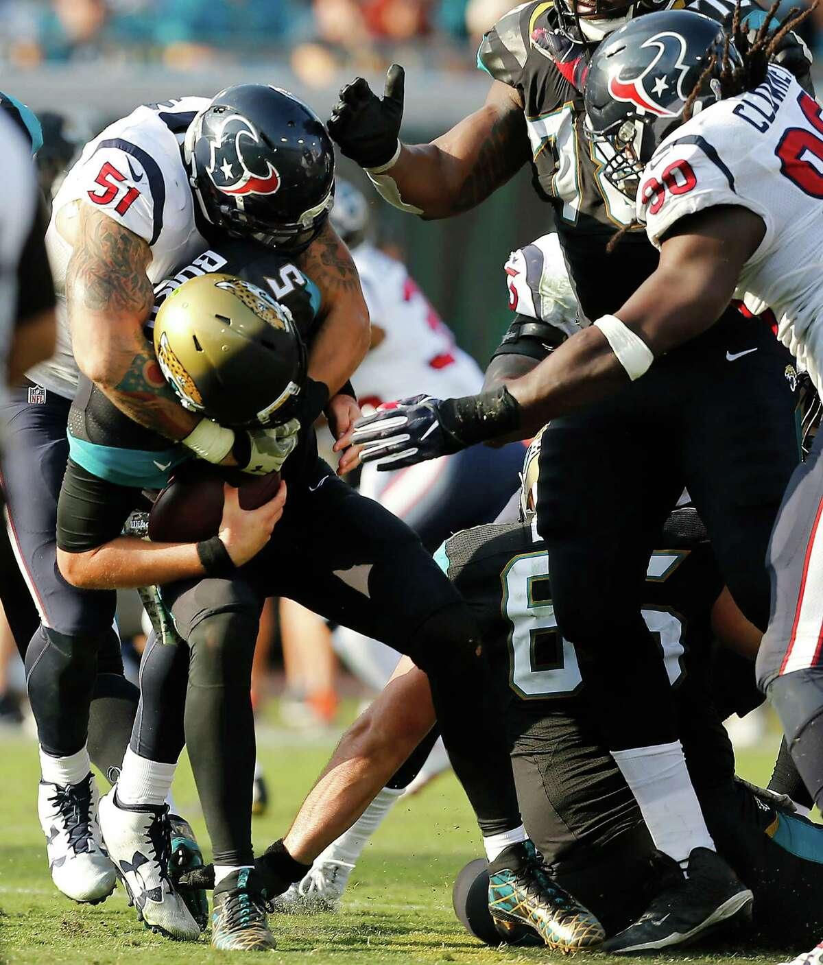 Texans linebacker John Simon (51) sacks Jacksonville's Blake Bortles (5) during the fourth quarter of Sunday's game at EverBank Field in Jacksonville.