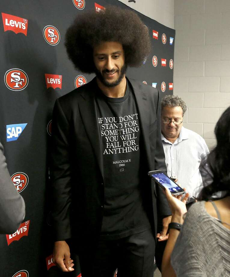 San Francisco 49ers quarterback Colin Kaepernick leaves after speaking after an NFL football game against the Arizona Cardinals, Sunday, Nov. 13, 2016, in Glendale, Ariz. The Cardinals won 23-20. (AP Photo/Ross D. Franklin) Photo: Ross D. Franklin, Associated Press