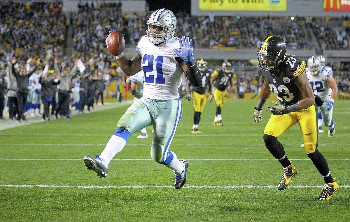 Dallas Cowboys running back Ezekiel Elliott (21) scores a fourth quarter touchdown in front of Pittsburgh Steelers free safety Mike Mitchell (23) as the Dallas Cowboys beat the Pittsburgh Steelers 35-30 on Sunday, Nov. 13, 2016 at Heinz Field in Pittsburgh, Pa.