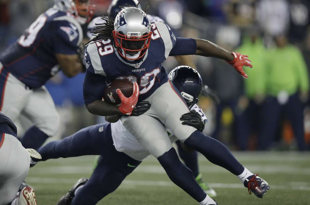 New England Patriots running back LeGarrette Blount (29) runs from Seattle Seahawks safety Kam Chancellor, rear, during the second half of an NFL football game, Sunday, Nov. 13, 2016, in Foxborough, Mass. (AP Photo/Charles Krupa)