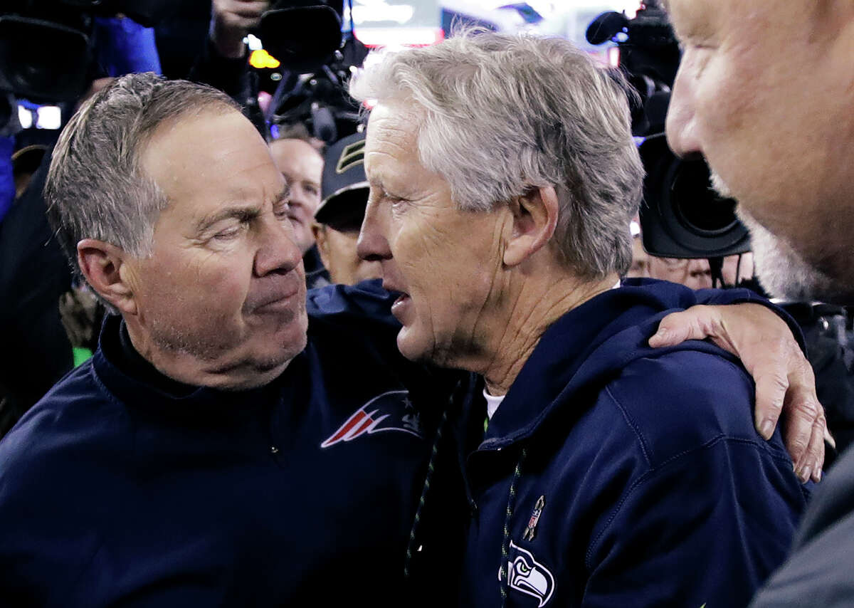 New England Patriots head coach Bill Belichick, left, and Seattle Seahawks head coach Pete Carroll speak at midfield after an NFL football game, Sunday, Nov. 13, 2016, in Foxborough, Mass. The Seahawks won 31-24. (AP Photo/Charles Krupa)