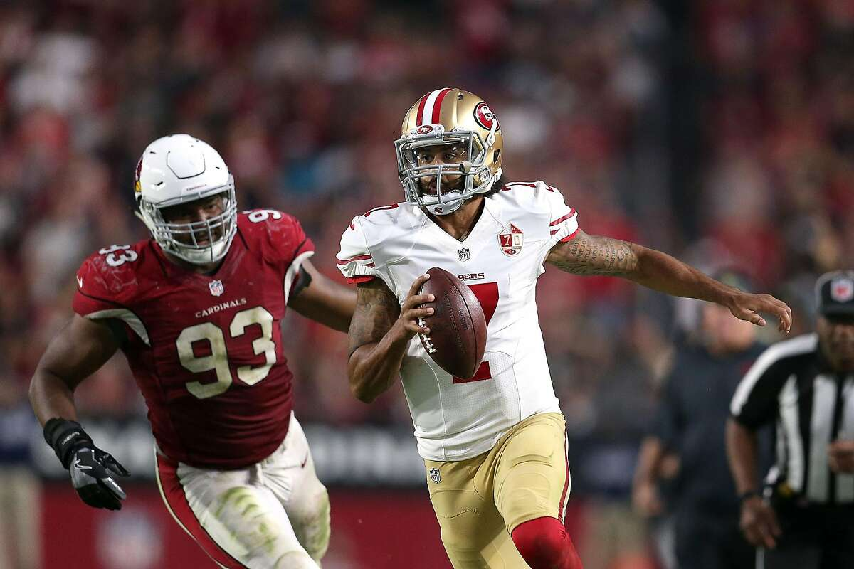GLENDALE, AZ - NOVEMBER 13: Quarterback Colin Kaepernick #7 of the San Francisco 49ers runs past defensive end Calais Campbell #93 of the Arizona Cardinals during the fourth quarter of the NFL football game at University of Phoenix Stadium on November 13, 2016 in Glendale, Arizona. Arizona won 23-20. (Photo by Chris Coduto/Getty Images)