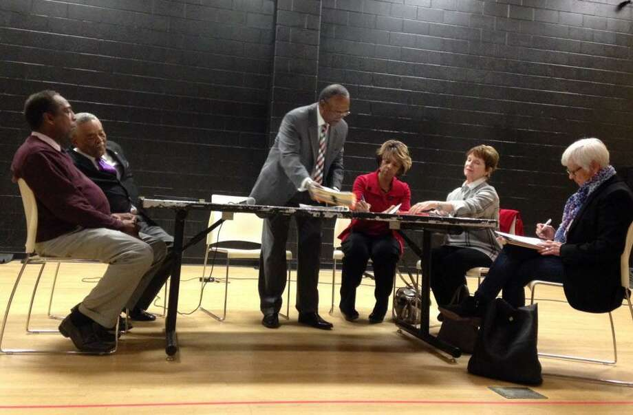 Michael Rush, (standing) a consultant from Ray & Associates, meets with community leaders to help create a profile of the next city schools superintendent. Johnson School. November 9, 2016. Photo: Linda C Lambeck / Linda C Lambeck