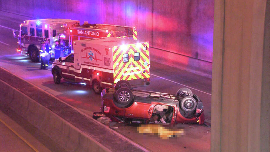 A man who fell 20 feet onto the lower lanes of Interstate 35 near downtown died early Monday, Nov. 14, 2016, according to police. Photo: Ken Branca