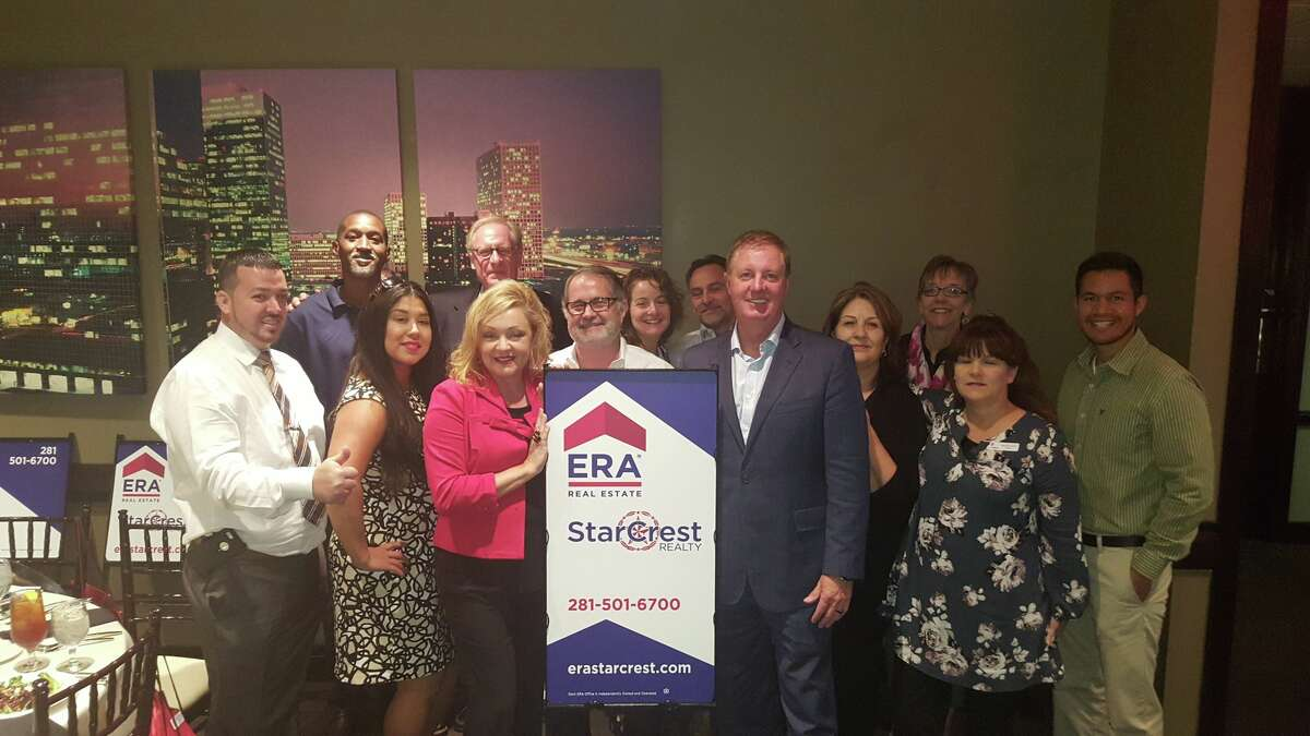 ERA StarCrest Realty team members. The firm has eight offices in the Houston and Dallas-Fort Worth areas.