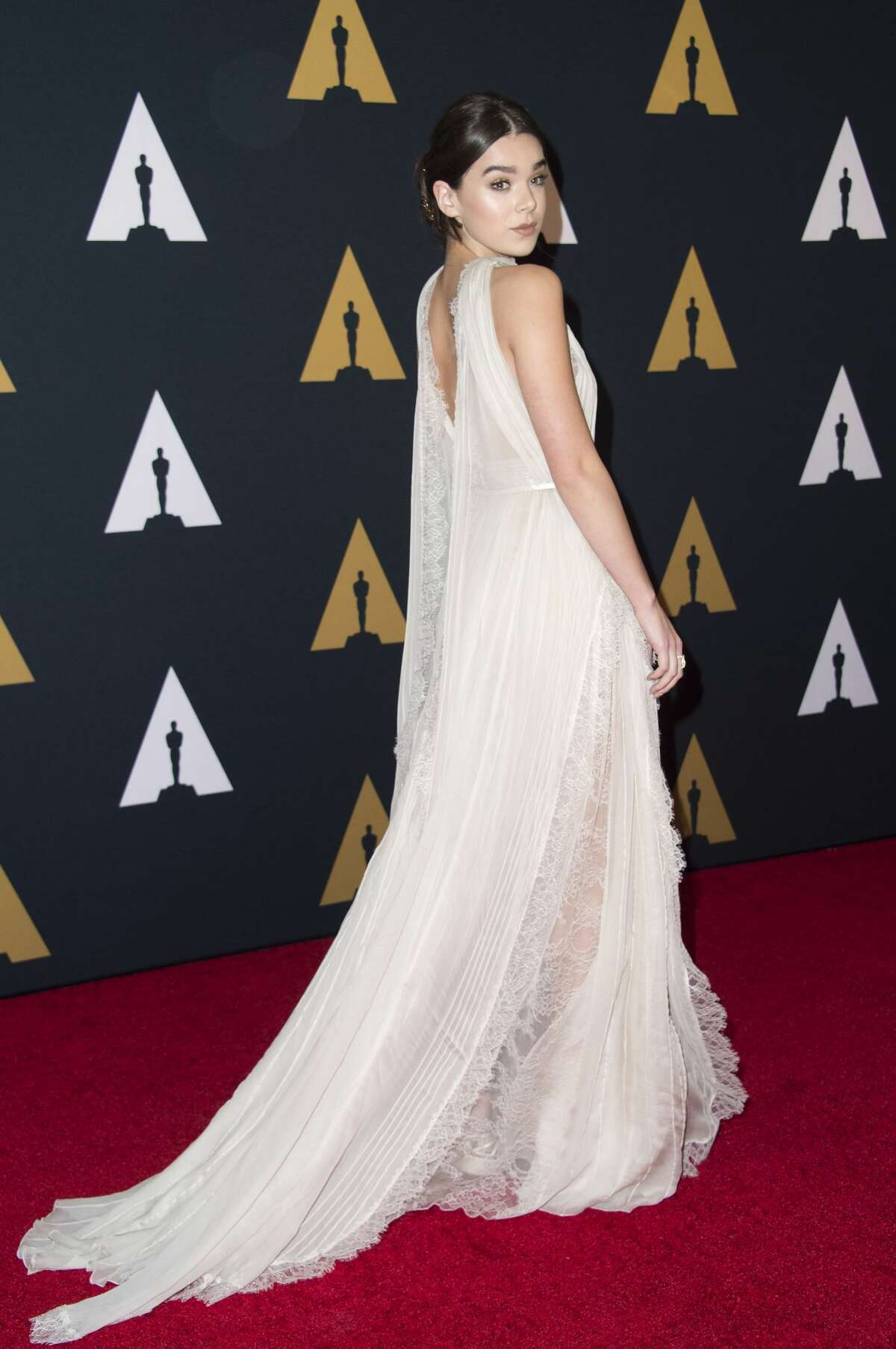 Actress Hailee Steinfield wears white with a fun and flirty lace draping.