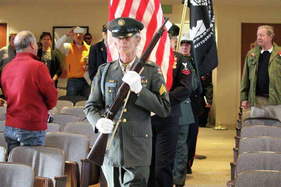 The color guard marches at the Veterans Day ceremony in Westport Town Hall on Nov. 11, 2016 in Westport, CT. Photo: Chris Marquette / Hearst Connecticut Media / Westport News