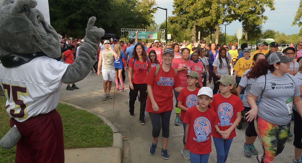 The Summer Creek High School mascot, left, cheers on participants at the start of the Greater Lake Houston Heart Walk at Lone Star College - Kingwood on Nov. 5, 2016. (Photo by Jerry Baker/Freelance)