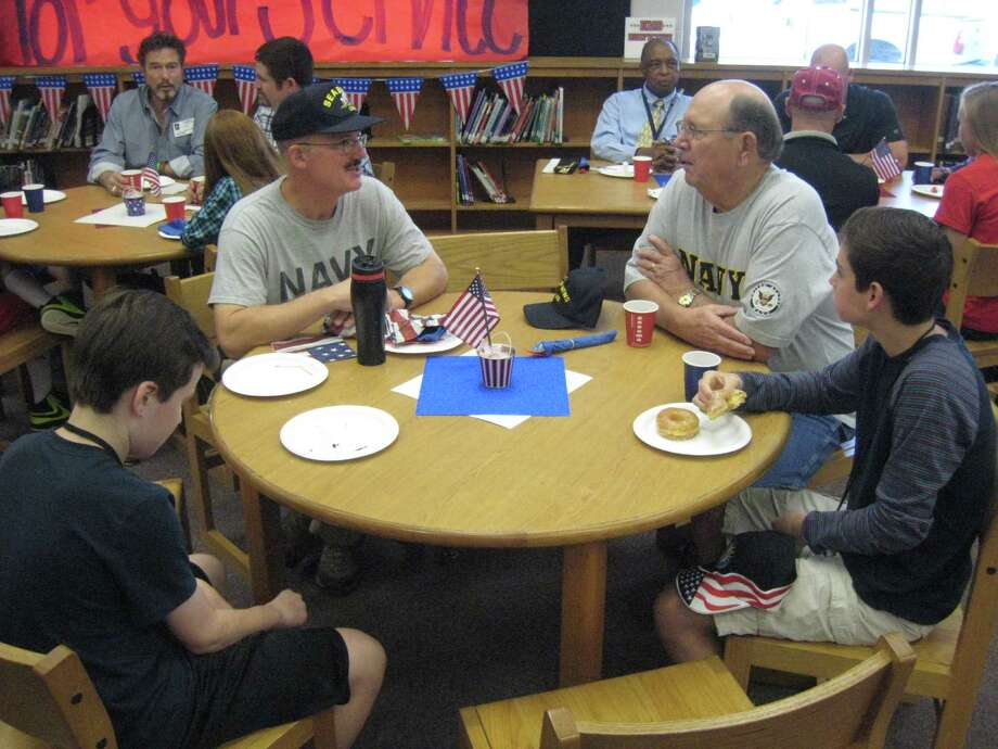 For Navy veterans Don Robison and Kevin Nalley, it was an honor to be invited to the Veterans Day breakfast especially because both had grandchildren who attend the school and they had the chance to share their experiences. Photo: Jennifer Summer