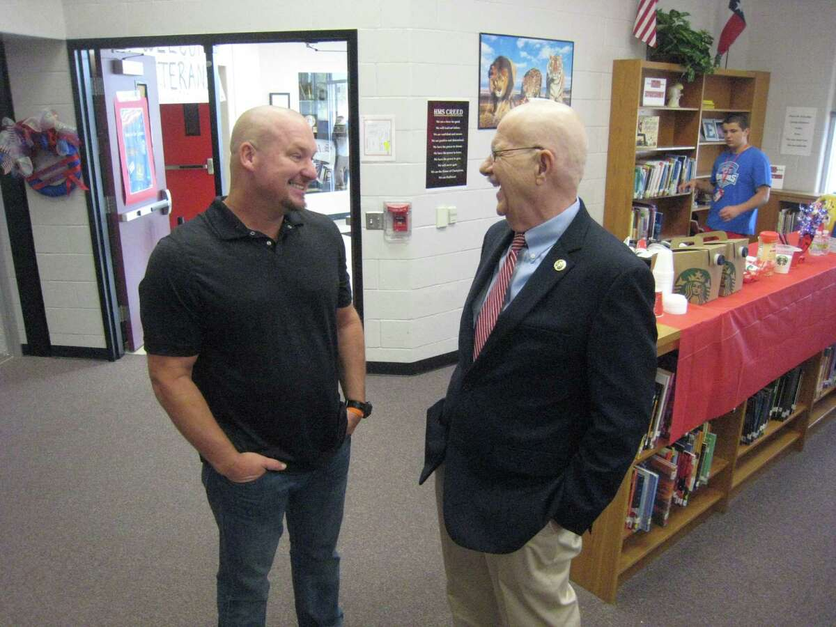 Reagan Hodges speaks with Congressman Ted Poe during the Huffman Middle School's Veterans Day Breakfast Friday, Nov. 11.