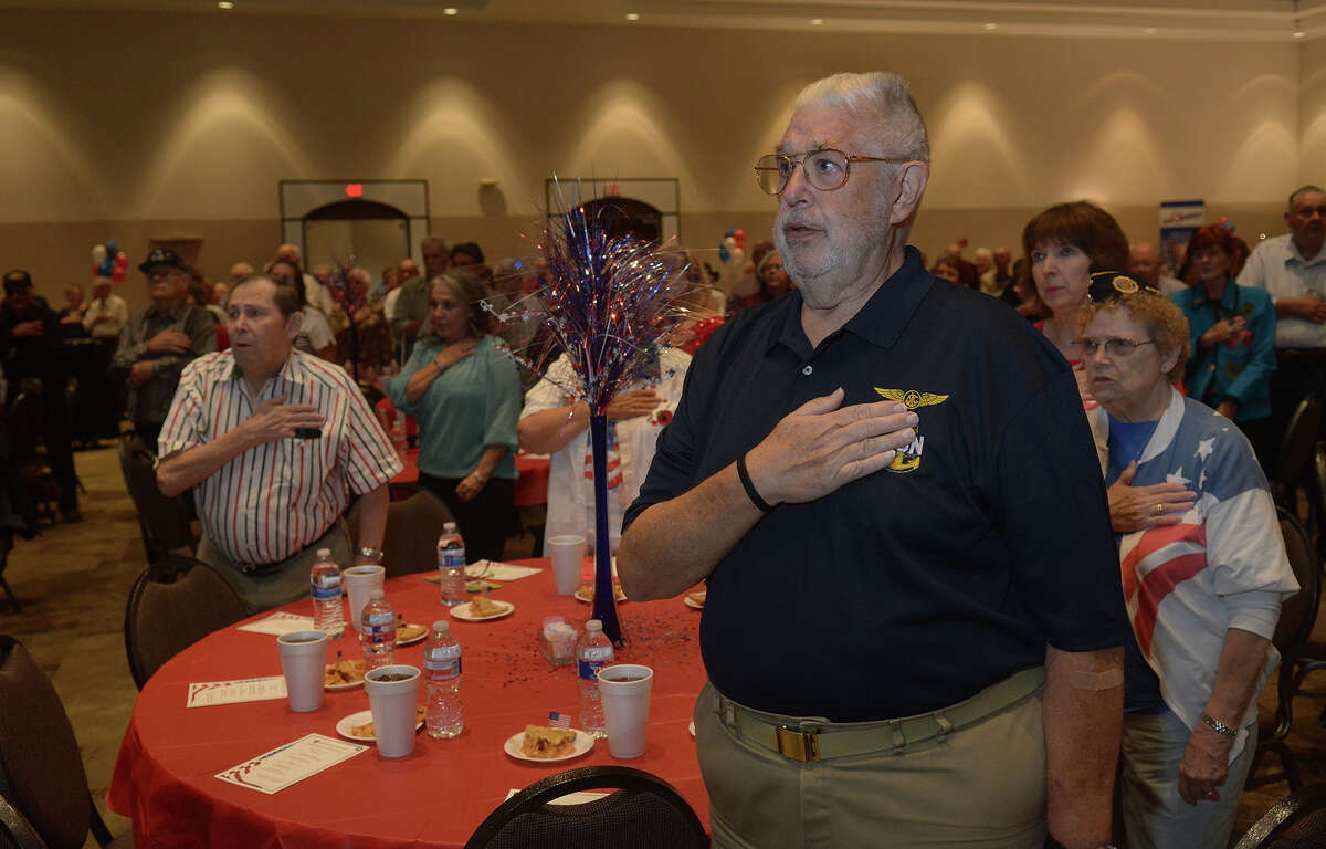 U.S. Navy veteran Bob Schenck, right, stands for the Pledge of Allegiance during the Tribute to Veterans event at The Humble Civic Center on Nov. 9, 2016. (Photo by Jerry Baker/Freelance)