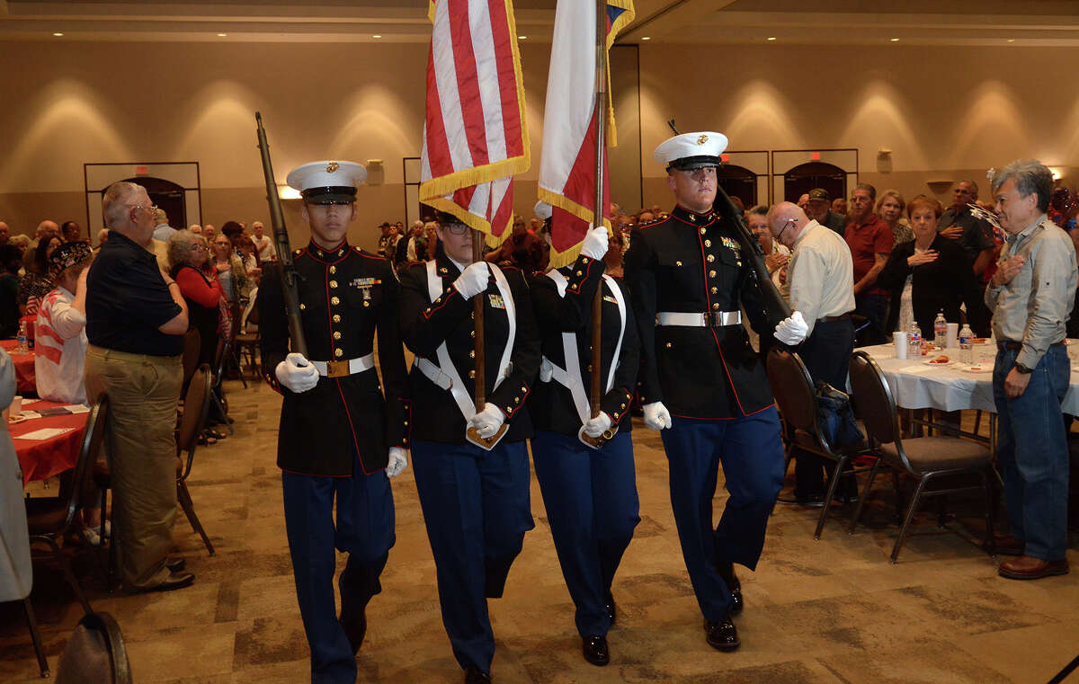 Atascocita High School Marine Corp Junior ROTC color guard members Cadet Sgt. Kenneth Estrada, from left, a sophomore, Cadet Col. Sydney Williams, a senior, Cadet SSgt. Nicole Guerrero, a sophomore, and Cadet Capt. Max Ruzic, a senior, present the colors during the Tribute to Veterans event at The Humble Civic Center on Nov. 9, 2016. (Photo by Jerry Baker/Freelance)