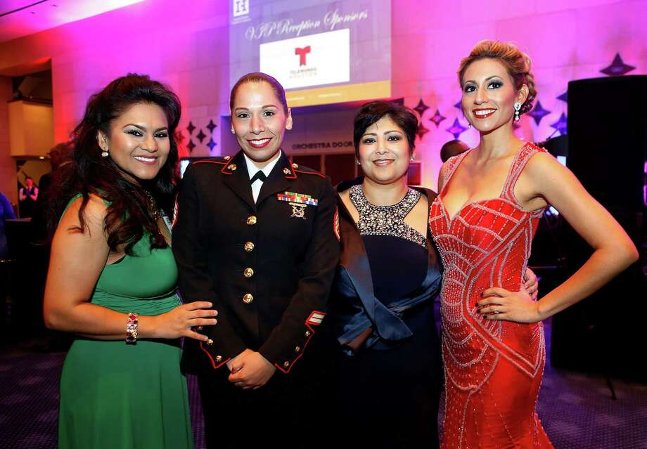 Leticia Velasquez, SSgt. Kim Eastwood of the United States Marine Corps, Gloria Scott and Angela Platsas during the Houston Hispanic Chamber of Commerce Annual Awards gala on Saturday, Nov. 12, 2016. (Annie Mulligan / Freelance) Photo: Annie Mulligan / For The Houston Chronicle / @ 2016 Annie Mulligan & the Houston Chronicle
