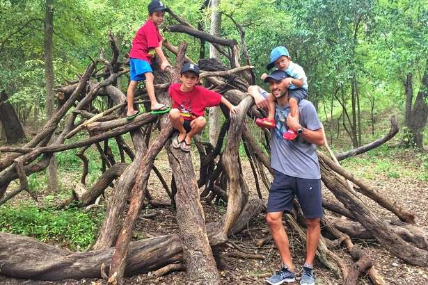 Spurs star Manu Ginobili poses with his three sons, twins Dante and Nicola. and Luca (on Ginobili's shoulders).