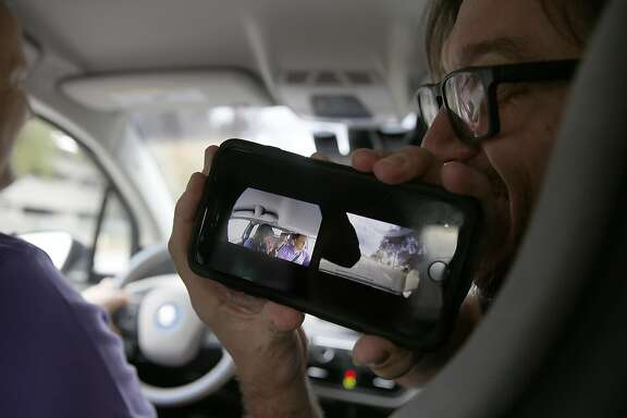 Nauto director of product Harris Warren (right) shows cameras live as Nauto founder Stefan Heck (left) does a test drive on Friday, November 11, 2016, in Palo Alto, Calif.  The dashcam that uploads relevant information to the cloud uses artificial intelligence to learn about driving patterns.