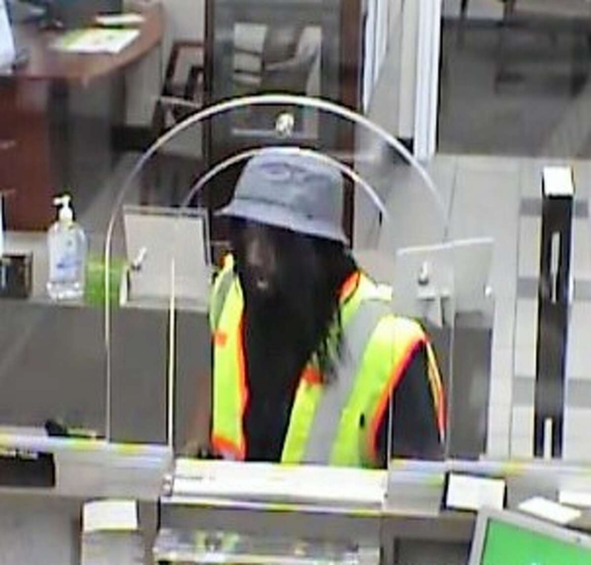 Surveillance photo shows a suspect during an armed bank robbery at the Pearland Regions Bank on McHard Road on May 27, 2016. FBI and Pearland police are offering a reward for tips leading to the identification of three suspects.