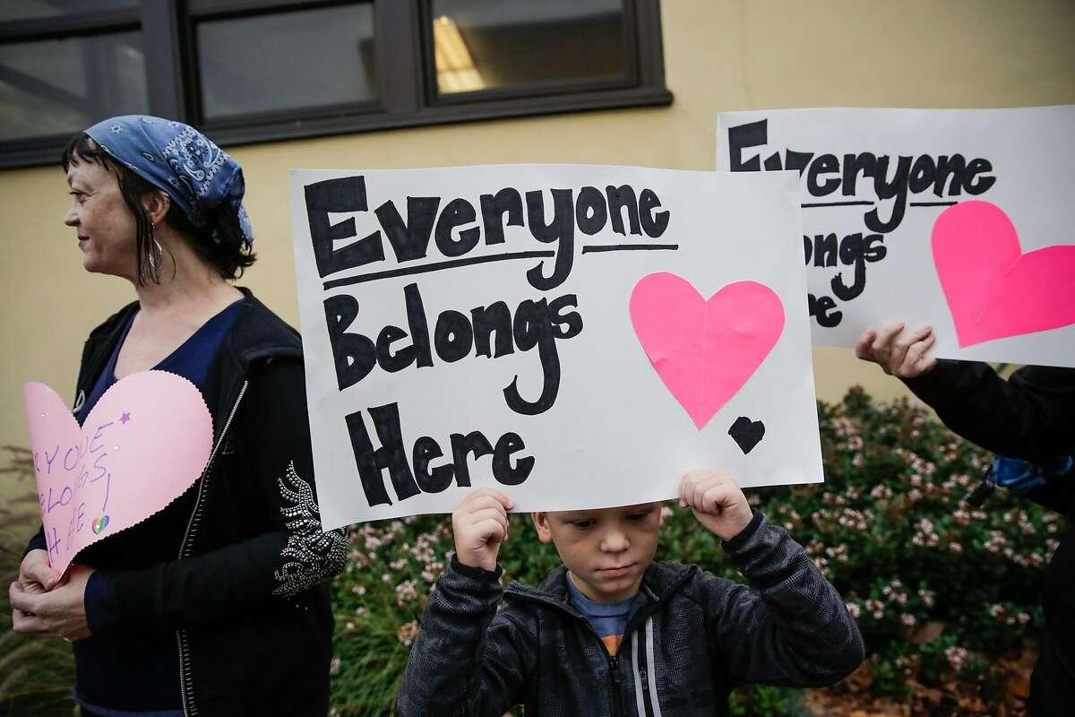 Student Evan Hackett, 7, held up a sign reading