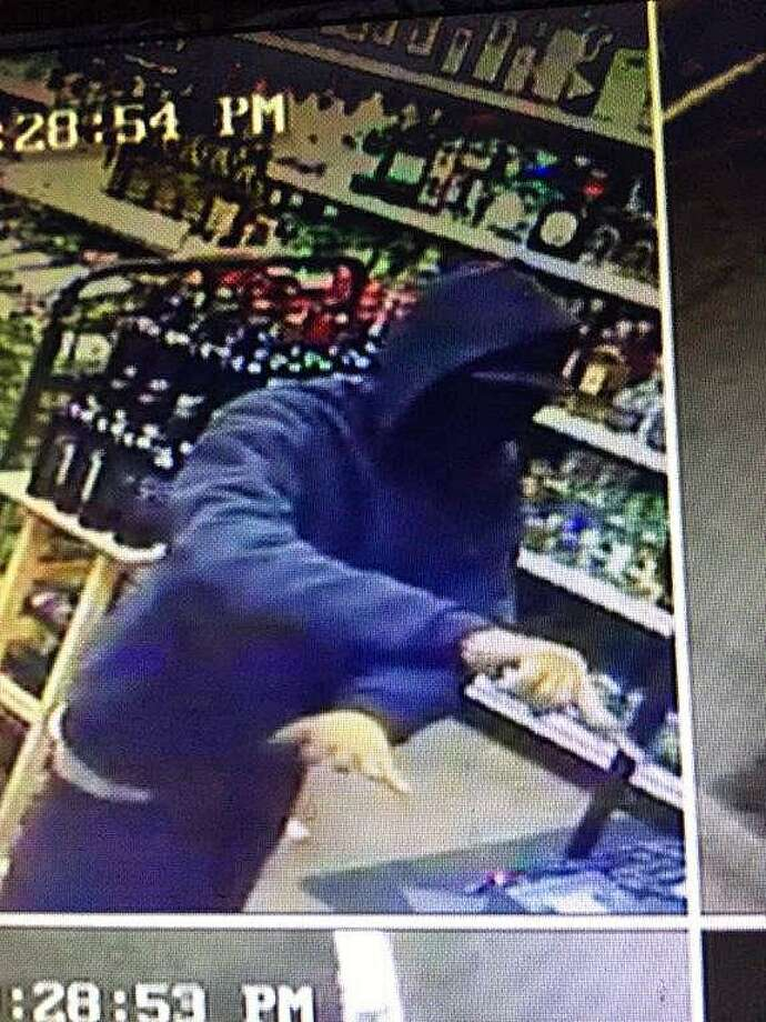 Police are searching for the suspect in armed robbery of Pequot Liquor on Nov. 10. Fairfield, CT. 11/11/16 Photo: Contributed / Contributed Photo / Fairfield Citizen