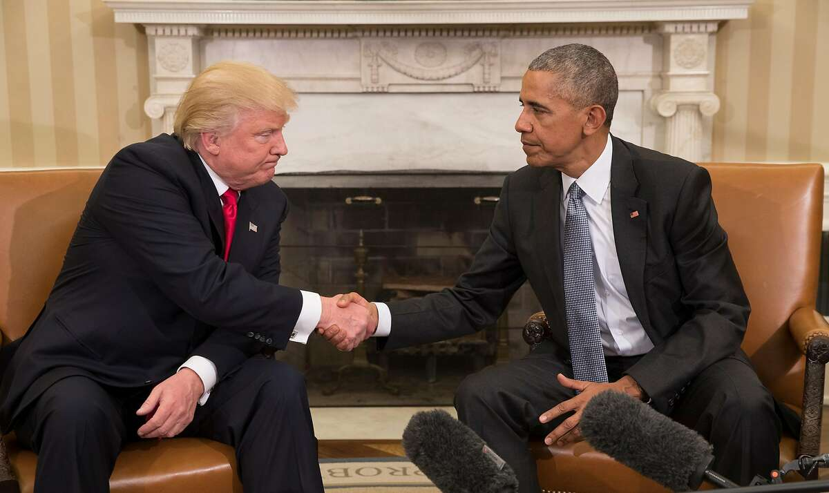 Donald Trump, the president-elect, shakes hands with President Barack Obama during a meeting in the Oval Office of the White House in Washington, Nov. 10, 2016. (Stephen Crowley/The New York Times)