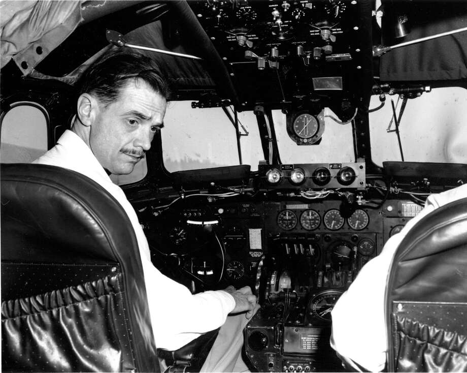 "Airplane manufacturer Howard Hughes is shown at the controls of his eight-engine wooden flying boat ""The Spruce Goose"" on Oct. 31, 1947. Photo: Associated Press File Photo / AP"