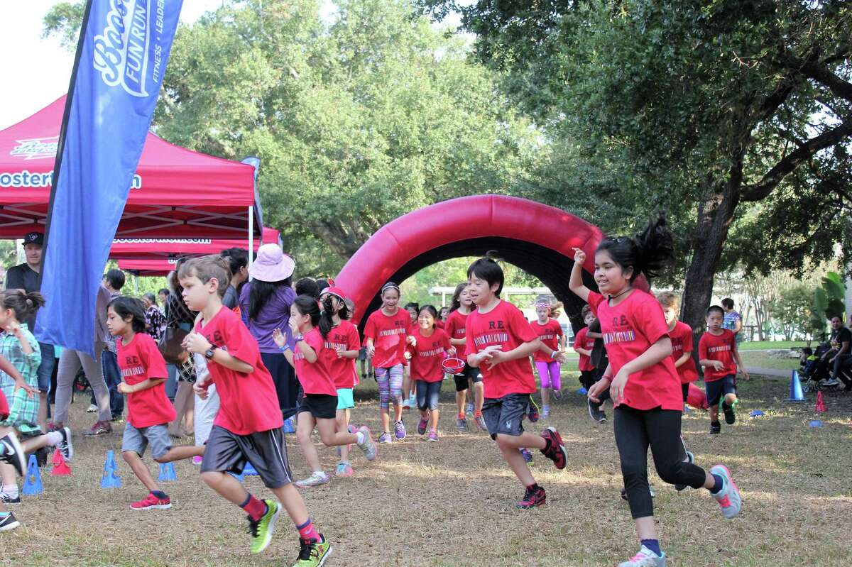 Roberts Elementary School Students donned their red Roberts shirts on Nov. 4 for a Fun Run to raise funds for the school's Spark Park, playing fields and track. Students were encouraged to run as many laps as possible. Thanks to their efforts the Fun Run raised more than $60,000.