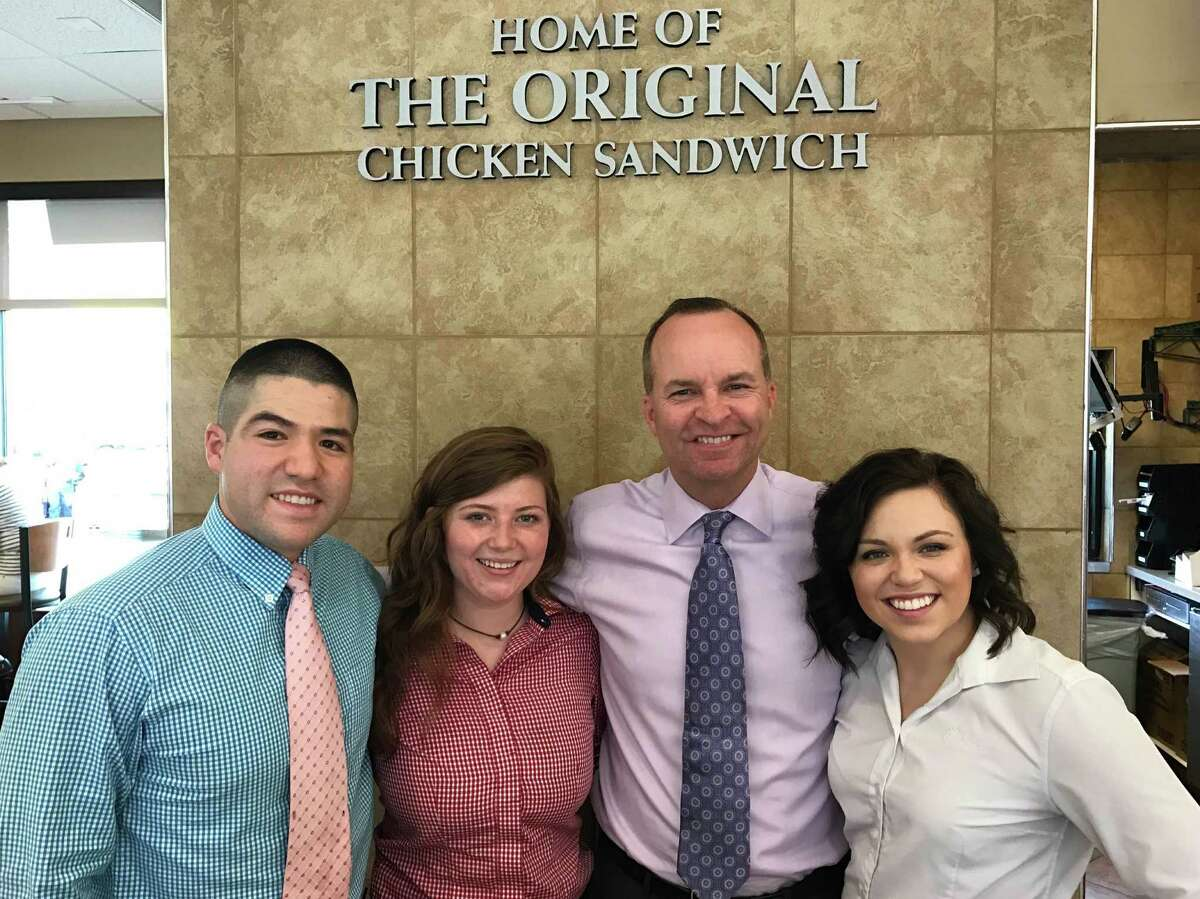 Rusty Wylie, Chick-fil-A franchise owner, poses with scholarship recipients. From left are Luis Gomez, University of Houston, Hotel and Restaurant Management; Avery Fontenot, Lone Star College-CyFair, Wylie and Stefany Gonzalez, Grand Canyon University, biblical studies.