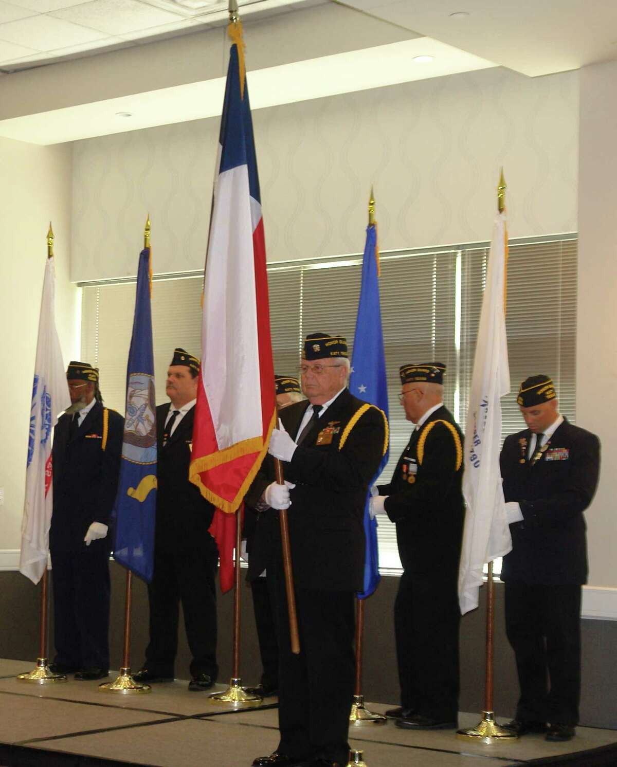 Members of the VFW Post No. 9182 Color Guard present the colors at the Salute to Veterans on Friday, Nov. 11, at Norris Convention Center.