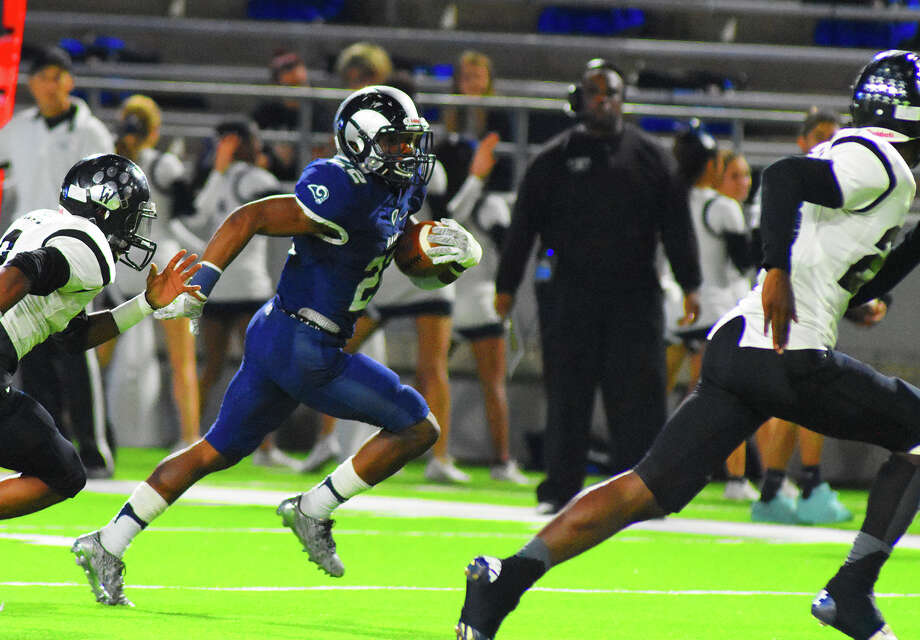 Cy Ridge senior running back Trelon Smith gouges the Westside defense for a first down in the second half of Friday's 30-13 bi-district win. Smith finished with 168 yards and one touchdown on 26 carries. Photo: Tony Gaines / HCN