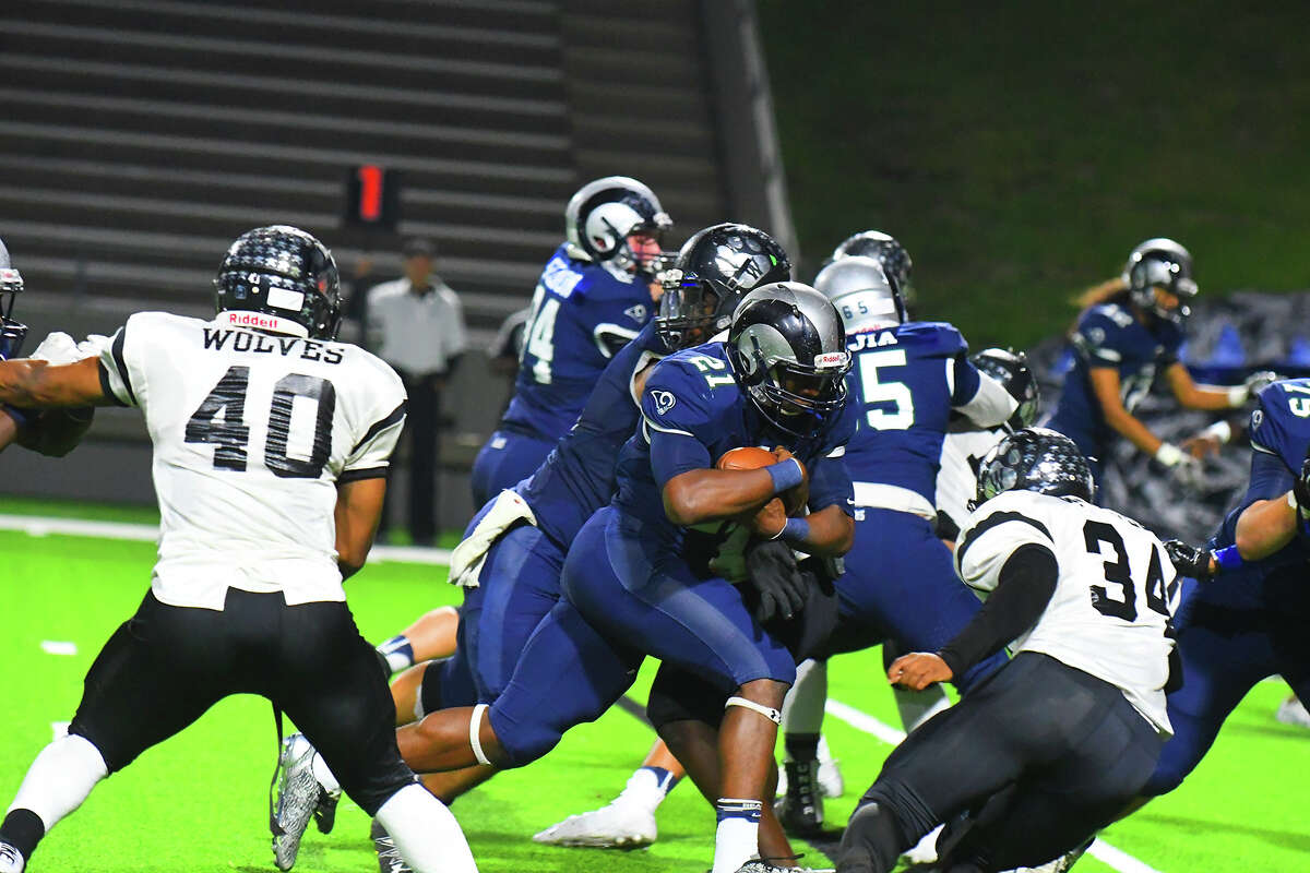 Cy Ridge junior running back Alex Jacobs fights for a first down in Friday's contest against Houston Westside. Jacobs was singularly effective in his limited touches, averaging 11.8 yards per carry on four rushing attempts, including a one-yard touchdown rush early in the second quarter.