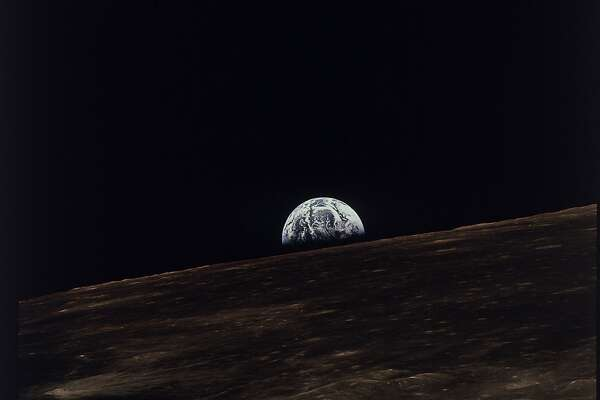 The earth is shown rising above the moon's horizon as seen from the Apollo 11 spacecraft, July, 1969. (AP photo/NASA)