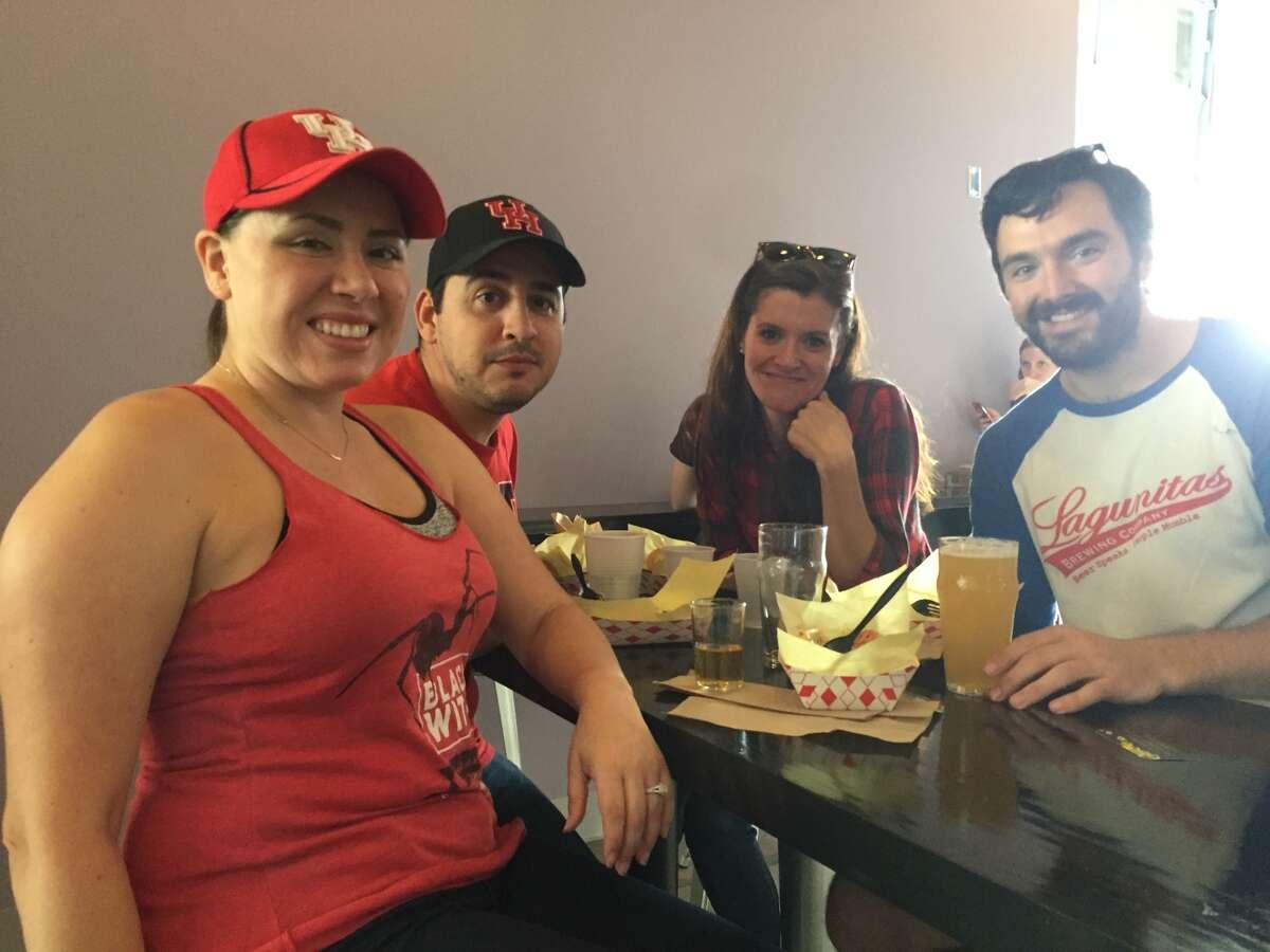 Front-left, Lisa Marker; back-left, Michael Marker; back-right, Jaime Marker; front-right, Ryan Beaudyn enjoy Holler Brewing Co. beer and food truck fare.
