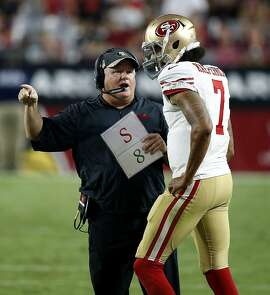 San Francisco 49ers head coach Chip Kelly talk with quarterback Colin Kaepernick (7) during the second half of an NFL football game, Sunday, Nov. 13, 2016, in Glendale, Ariz. (AP Photo/Ross D. Franklin)