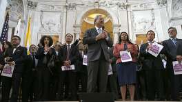 Mayor Ed Lee leads a unity rally with other city elected officials in response to Trump's election at the City Hall rotunda on Monday, November 11, 2016, in San Francisco, Calif.