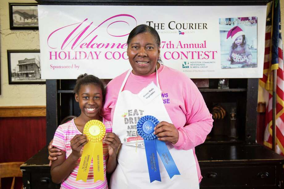 Vegetable contestant Denise Walls poses for a photo with her 11-year-old daughter Tara McShan after winning first place in the Vegetables category and the Chef Bob Robinson Award during the 27th Annual Holiday Cooking Contest on Oct. 29 at McKenzie's Barbeque in Conroe. Photo: Michael Minasi, Staff / © 2016 Houston Chronicle
