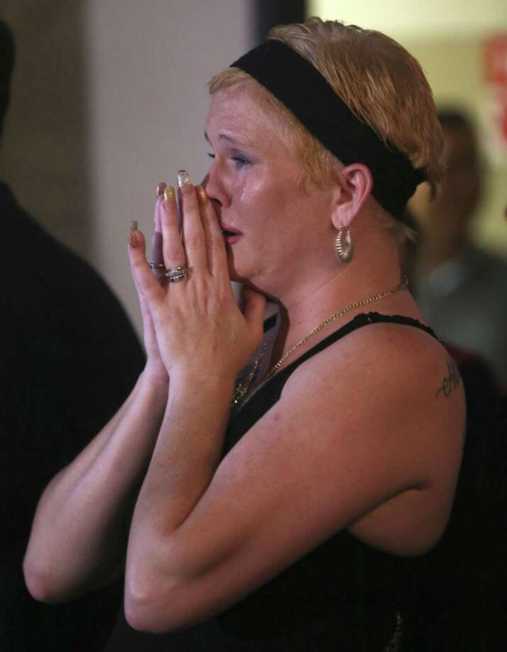 Kimberle Wright is brought to tears Tuesday, Nov. 8, 2016 at the Bexar County GOP headquarters as Donald Trump's electoral college lead widens over Hillary Clinton during the 2016 presidential election. Photo: William Luther, Staff / San Antonio Express-News / © 2016 San Antonio Express-News