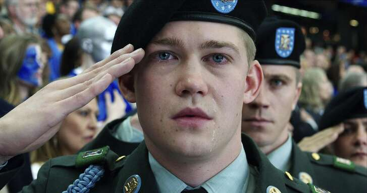 "This image released by Sony Pictures shows Joe Alwyn, portraying Billy Lynn, in a scene from the film, ""Billy Lynn's Long Halftime Walk,"" in theaters on November 11. (Mary Cybulski/Sony-TriStar Pictures via AP)"